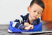 A boy playing a game on computer tablet — Stock Photo