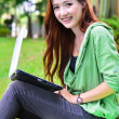 Beautiful young asian student smiling with computer nootbook — Stock Photo