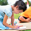Going back to school, Children drawing and painting over green g — Stock Photo