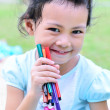 Going back to school : girl holding color pens — Stock Photo