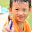 Going back to school : little boy holding color pens — Stock Photo #30368601