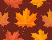 Autumnal maple leaves seamless pattern — Stock Vector