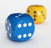 Blue and yellow dice — Stock Photo