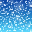 Snowflakes bokeh blue background — Stock Vector #36458815