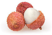 Three lychees isolated on white background — Stock Photo