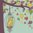 Bird-in-cage-and-autumn-leaves - Stock Photo