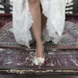 Bride's legs on a truck — Stock Photo