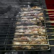 Greek pork souvlaki on grill — Stock Photo