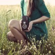 Brunette girl with retro camera — Stockfoto #27684137