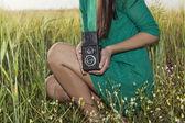 Brunette girl with retro camera — Stock Photo