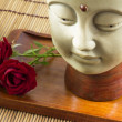 Stock Photo: Buddhwith rose