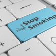 Stylish keyboard close up view with blue button stop smoking and — Stock Photo