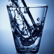 Water splash in a glass — Stock Photo