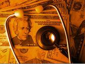 Medical costs profits stethoscope — Stock Photo
