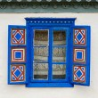 Stock Photo: Blue painted traditional window with blue open shutters in Tulcea, Romania
