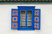 Blue painted traditional window with blue open shutters in Tulcea, Romania — Stock Photo