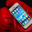 IPhone 5 Apps illuminated screen in a red box glove — Stock Photo