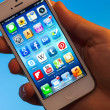 Illuminated iPhone 5 Apps hold in hand — Stock Photo #18862619