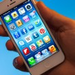 Stock Photo: Illuminated iPhone 5 Apps hold in hand