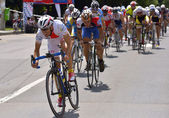 PLOIESTI-BUCHAREST - JULY, 05: Action scene during the race, with cyclists competing for Road Grand Prix event, a high-speed circuit race, July 05, 2014 in Ploiesti-Bucharest, Romania — Stock Photo