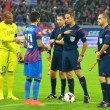 BUCHAREST-JULY,23:Captains and referees from the football match between Steaua Bucharest and Stromsgodset IF Norway, during the UEFA Champions League 2nd qualifying round. Steaua won 2-0, July 23,2014 — Stock Photo #50114075