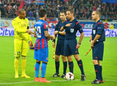 BUCHAREST-JULY,23:Captains and referees from the football match between Steaua Bucharest and Stromsgodset IF Norway, during the UEFA Champions League 2nd qualifying round. Steaua won 2-0, July 23,2014 — Stock Photo