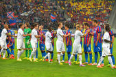 BUCHAREST-JULY,23:Ceremony of the beginning of a football match between Steaua Bucharest and Stromsgodset IF Norway, during the UEFA Champions League 2nd qualifying round. Steaua won 2-0, July 23,2014 — Stock Photo