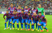 BUCHAREST-JULY,23:Football team Steaua Bucharest before the match with Stromsgodset IF Norway, during the UEFA Champions League 2nd qualifying round. Steaua won 2-0, July 23,2014 — Stock Photo