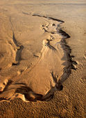 Sandy background of the dried river bed. — Stock Photo
