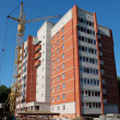 Foto Stock: Construction of multi-storey brick building.
