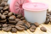Capsules and coffee beans — Stock Photo