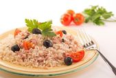 Rice with tuna, tomatoes and black olives — Stock Photo