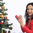 Stock Photo: Happy woman with gift box and christmas tree