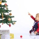 Baby and christmas tree — Stock Photo