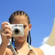 Little girl with a camera — Stock Photo #15704363