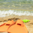 Stock Photo: Flippers on sandy beach