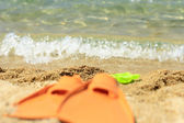 Flippers on sandy beach — Stock Photo