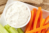Ranch dressing with carrots and celery — Stock Photo