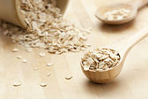 Healthy Dry Oatmeal in a wooden spoon — Stock Photo