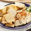 Homemade Crunchy PitChips with Hummus — Stock Photo #20506415