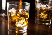 Golden Brown Whisky on the rocks — Stock Photo