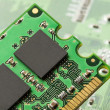 Stock Photo: Green Electrical Circuit Board with microchips and transistors