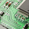 Green Electrical Circuit Board with microchips and transistors - Foto Stock