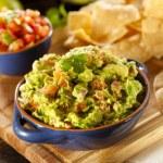 Homemade Organic Guacamole and Tortilla Chips — Stock Photo #26793759