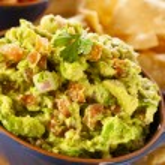 Homemade Organic Guacamole and Tortilla Chips — Stock Photo #26793961