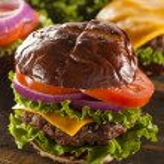Gourmet Cheese Burger on a Pretzel Roll — Stock Photo #29243077