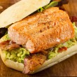 Grilled Salmon Sandwich with Bacon and Guacamole — Stock Photo
