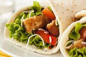 Breaded Chicken in a Tortilla Wrap — Stock Photo