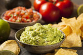 Green Homemade Guacamole with Tortilla Chips — Stock Photo