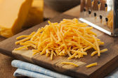 Organic Shredded Sharp Cheddar Cheese — Stock Photo